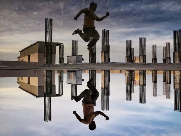 Puddle play Sky Reflection Cloud - Sky Water Real People Leisure Activity EyeEm Ready   Waterfront Outdoors Jumping Men Mid-air Puddle People
