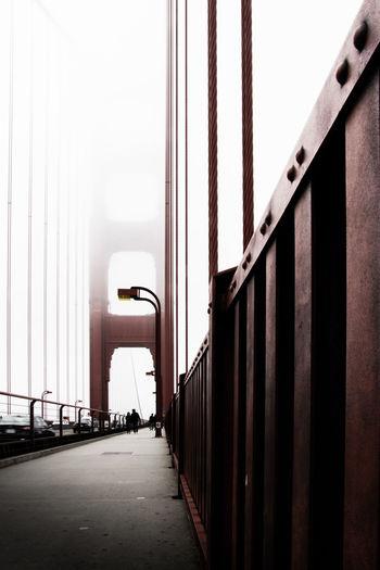 Bridge amidst buildings against sky