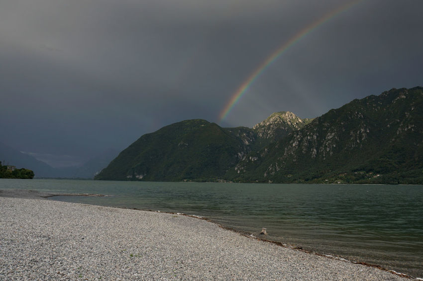Lago D'Idro Beauty In Nature Rainbow Scenics - Nature Water Mountain Tranquil Scene Sky Tranquility Idyllic No People Sea Non-urban Scene Nature Cloud - Sky Double Rainbow Beach Day Remote Outdoors Mountain Peak Capture Tomorrow