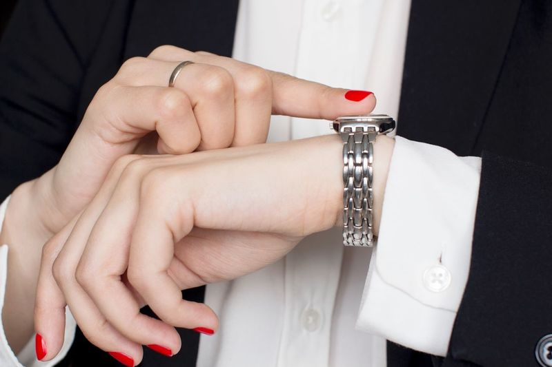 Young woman in black suit pointing wrist watch Red Nail Polish Busy Woman Hands Business Woman Strongwoman Office Power Black And White Blackandwhite Classical Style Working Hard Stylish Boss Suit Menswear Watch Wristwatch White Shirt Human Hand Hand Jewelry Ring Women Adult Bracelet Fashion Personal Accessory Red Nail Polish Close-up