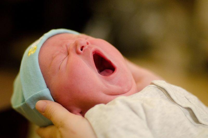 Close-up of baby boy yawning