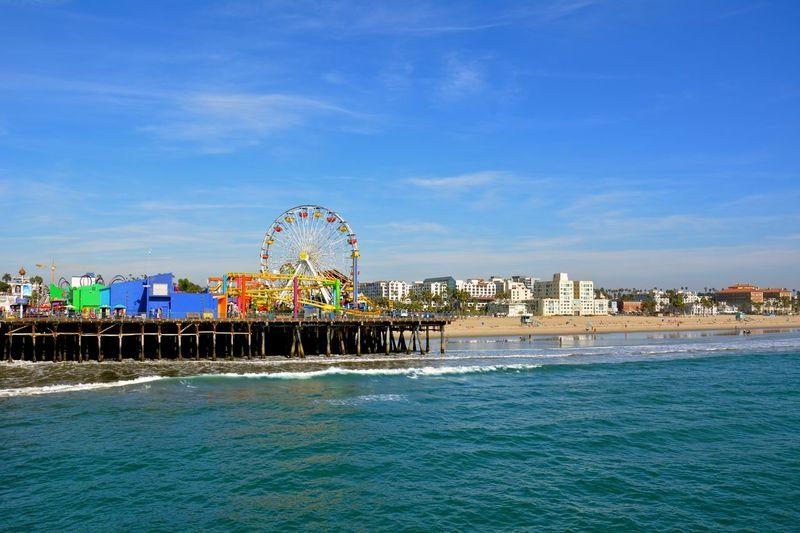 Amusement Park Rides On Santa Monica Pier Against Sky