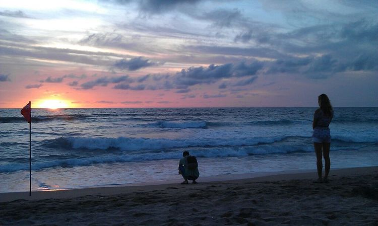 saw this foreign couple back in December 2011 was quite a story. they yelled at each other before the sunset, but they kissed passionately after the sunset. Couple Pantai Kuta (Kuta Beach) Watching The Sunset