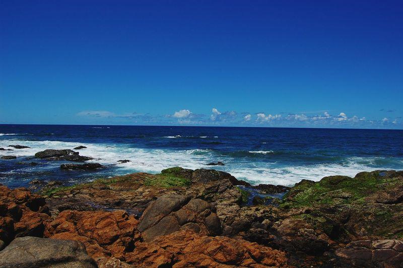 Idyllic shot of sea against blue sky