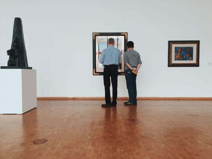 Men standing in front of man