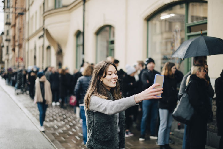 People standing on street in city