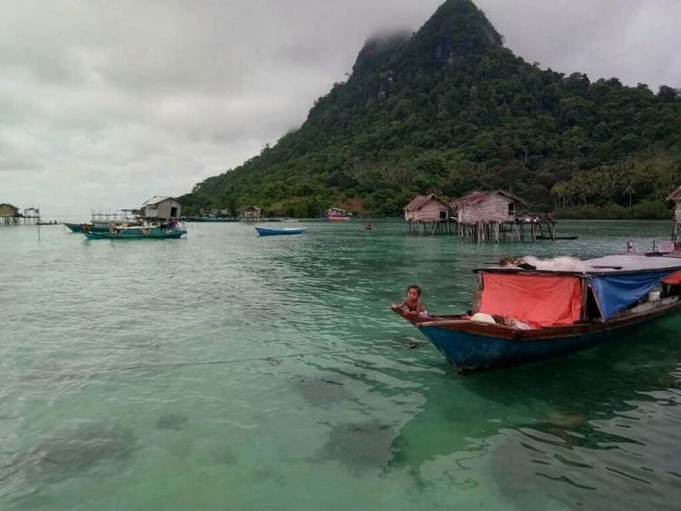 Boats village at Bodgaya Island, Semporna, Sabah, Malaysia. This photo captured at 20th. April. 2018 with the green sea and nice day. Nautical Vessel Water Sea Beach Moored Mountain Longtail Boat Tourist Resort Fishing Boat Fisherman Stilt House Buoy Fishing Net Fishing Fishing Tackle Rowboat Lagoon