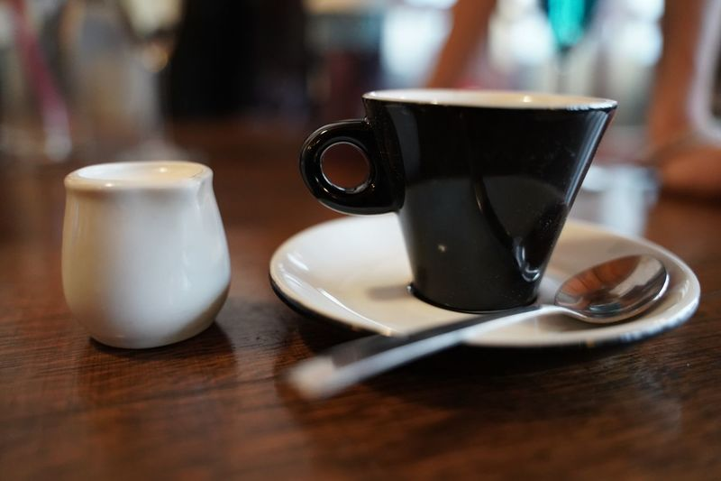 Espresso coffee on the table with milk Espresso Table Drink Food And Drink Mug Cup Coffee Coffee Cup Coffee - Drink Indoors  Close-up Spoon No People