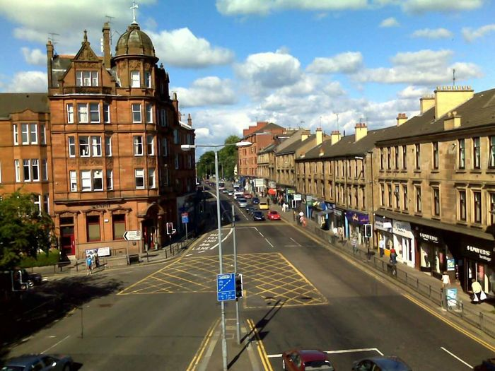 Shawlands Cross: Glasgow, Scotland. City Clouds Architecture City Life Outdoors Cloud - Sky Cityscape Day Scottish Scenery Nature Glasgow  Glasgow Streets Scotland Shawlands Building Exterior Sky Shops High Street Cars Traffic People And Places Neighborhood Map The Street Photographer - 2017 EyeEm Awards