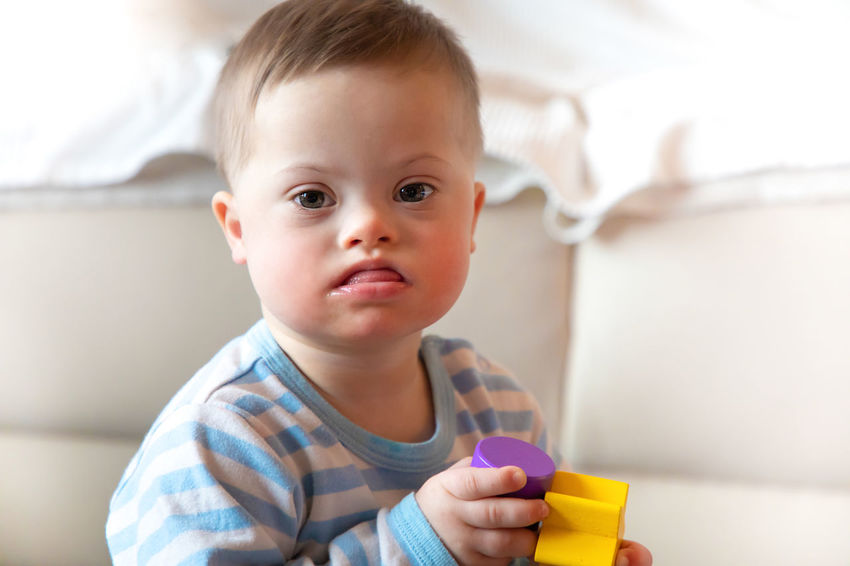 Babyboy Baby Child Childhood Cute Domestic Life Domestic Room Down Syndrome Front View Headshot Holding Home Interior Indoors  Innocence Lifestyles Looking At Camera Males  Mental Health  One Person Portrait Young