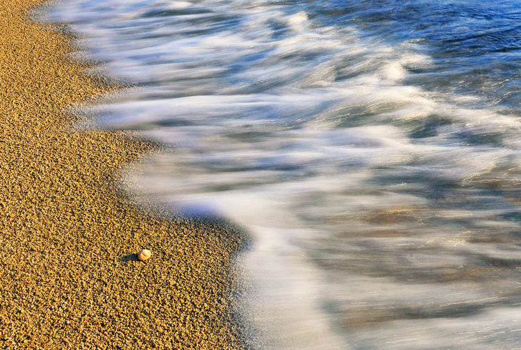 Small stone on sand beach see water waves Island of Pag Croatia Adriatic Sea Europe. Seascape Photography Beach Photography Beach Sand Beach Small Stone Adriatic Sea Adriatic Coastline Water Sea Tranquility Outdoors Day Nature Motion No People Beauty In Nature Sunlight Blurred Motion Wave Flowing Water Rock