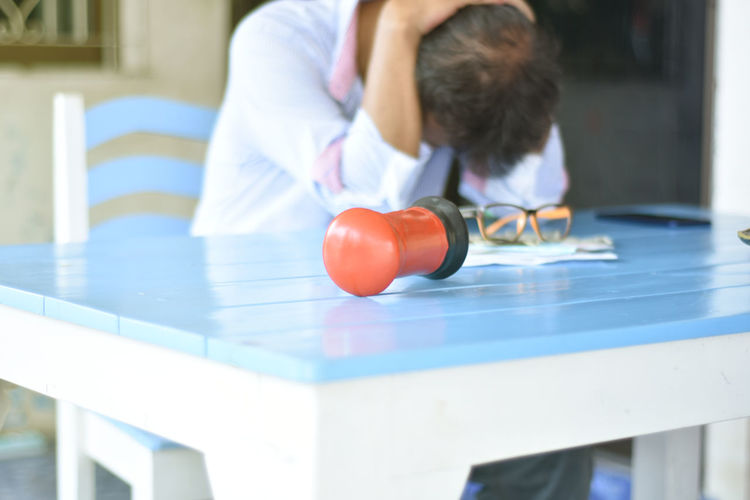 Boy playing with ball on table