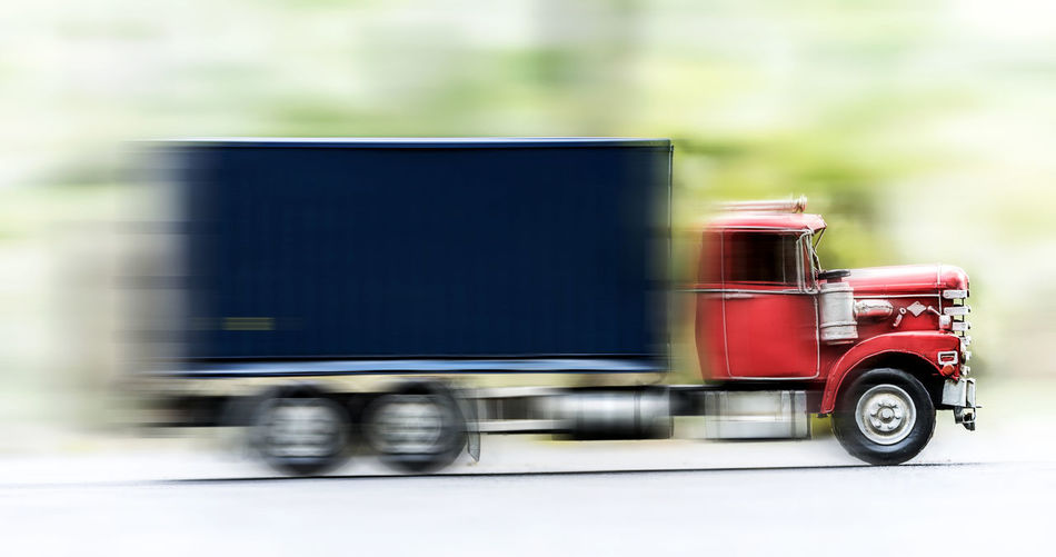 Blurred motion of truck on road in city