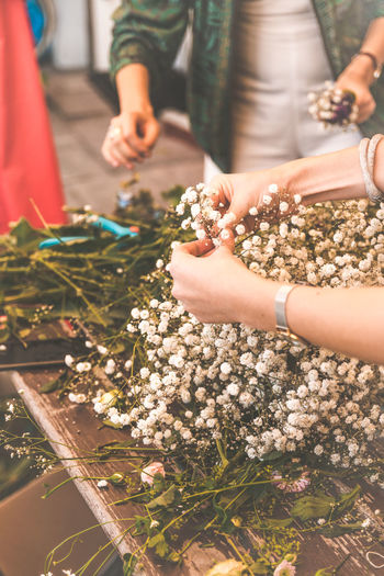Flower Wreath Human Hand Hand Holding Real People Women Adult Group Of People Nature People Human Body Part Belief Plant Religion Day Lifestyles Men Celebration High Angle View Finger