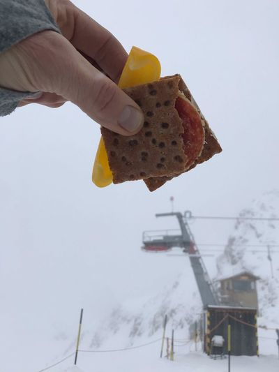 on mountain treat Winter Mountain Chairlift Snowboarding Skiing Snow Snack Time! Food Human Hand One Person Human Body Part Holding Real People