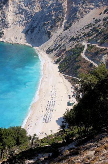 beautiful beach in kefalonia greece Kefalonia, Greece Beach Beauty In Nature Day Hot Spring Landscape Mountain Nature Outdoors Rock - Object Sand Scenics Sea Sky Torquoise Sea Tree Water