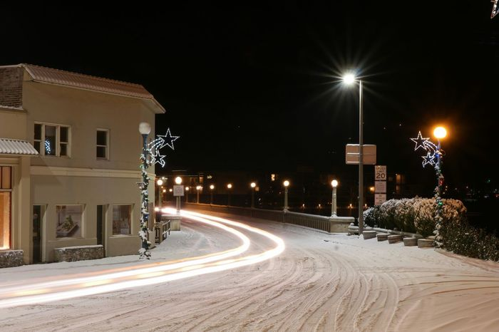 Photography In Motion Streaking Light Motion Driving Transportation Snowy Street Calming No People Night Lights Lake Chelan Bridge Buildings Nightlights Quiet Envision The Future Adapted To The City Mobility In Mega Cities