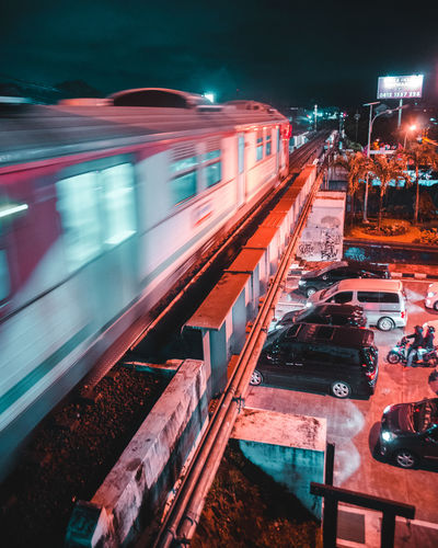 Blurred Motion Of Train On Railway Bridge At Night