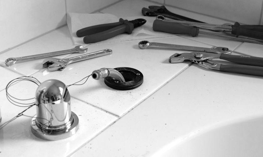 Bathroom repair. Repairing Repairs Bathroom Close-up Domestic Bathroom Domestic Room Faucet Flooring High Angle View Home Household Equipment Hygiene Indoors  Man Made Man Made Object Metal No People Repairing Bathroom Sink Still Life Table Tile Variation