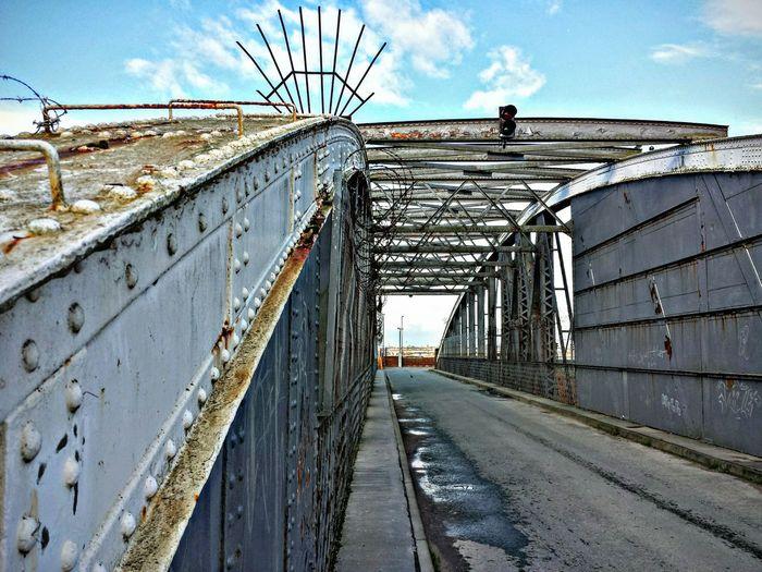 Old metallic bridge against sky