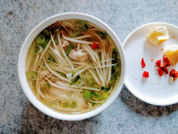 #pho and #chili, good alternative to hot chicken soup to get well super fast (: Vietnamese Food Pho Directly Above Hot Chilly Soup Food And Drink Healthy Eating Freshness Bowl Indoors  High Angle View Ready-to-eat Food No People Close-up