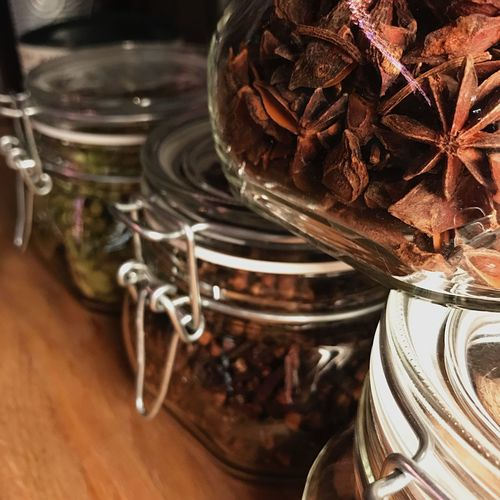 Close-up of spices in jars on table