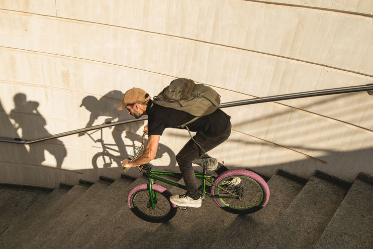 High angle view of man cycling on bicycle