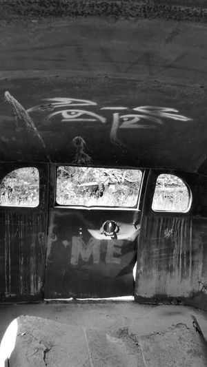 Taking Photos Abused Abandoned Inside Bus Left Behind Forgotten Abandoned & Derelict Old Old School Bus Old Bus Black & White Black And White Blackandwhite Derelict & Abandoned Derelict Neglected School Bus Door Graffiti