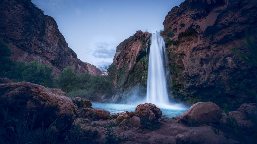 Havasu Falls is located deep in the valley in Grand Canyon area. There is no sunset here. it turns from bright to dark pretty fast. The water is unbelievably blue. Havasupai literally means people of blue and green water, which is referring to the native Indians here. Arizona Before Sunset Grand Canyon Havasupai Supai, AZ Beauty In Nature Cliff Havasu Falls Long Exposure Low Angle View Motion Mountain Nature No People Power In Nature Rock - Object Rock Formation Scenics Travel Destinations Water Waterfall