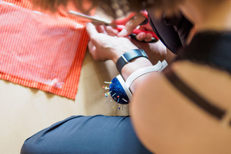 High angle view of dressmaker working
