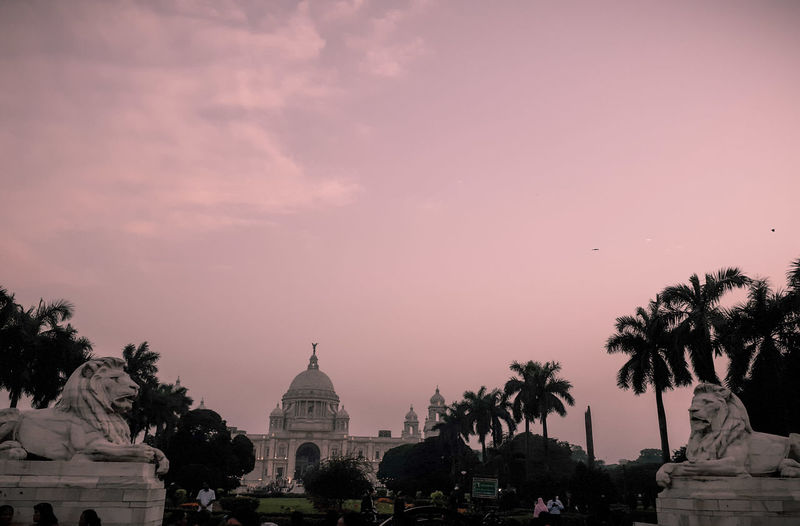 View of temple building against sky during sunset