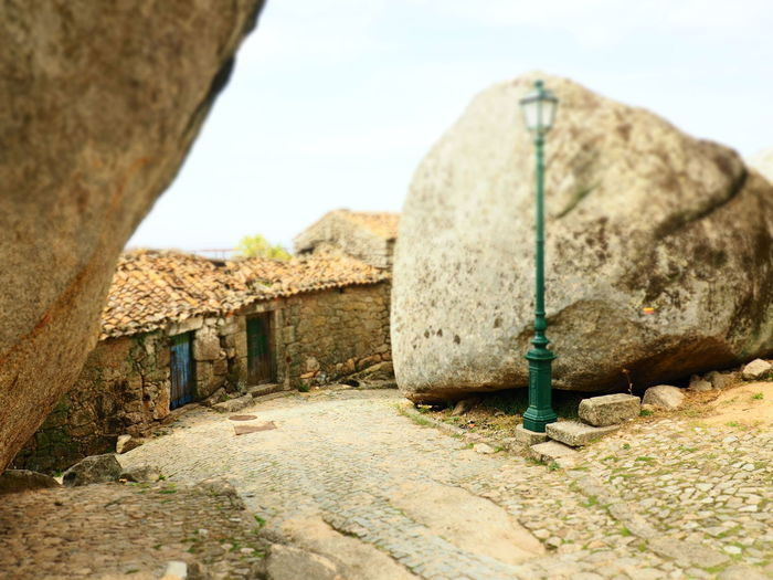 Rocks and houses Rock Stone House Street Rock - Object Sky Architecture Building Exterior Built Structure Close-up Residential Structure Country House