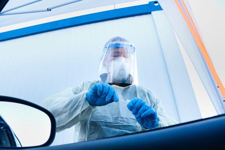 Portrait of person working in glass window