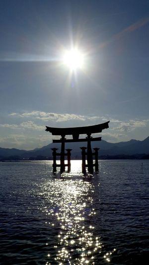 EyeEmNewHere Water Tranquility Sea Sun Torii Gate TORII Reflection Light Dusk Japan Miyajima Blue Peaceful Floating Torii Gate Gate Sun Effect Gegenlicht