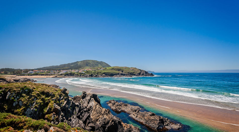 Landscape with sea,cliff, beach and blue sky. Galicia Spain. Vacation travel. Sea Water Sky Scenics - Nature Beach Land Beauty In Nature Clear Sky Tranquil Scene Blue Tranquility Copy Space Nature Horizon Over Water Rock Horizon Day Idyllic No People Outdoors Galicia SPAIN Cliff