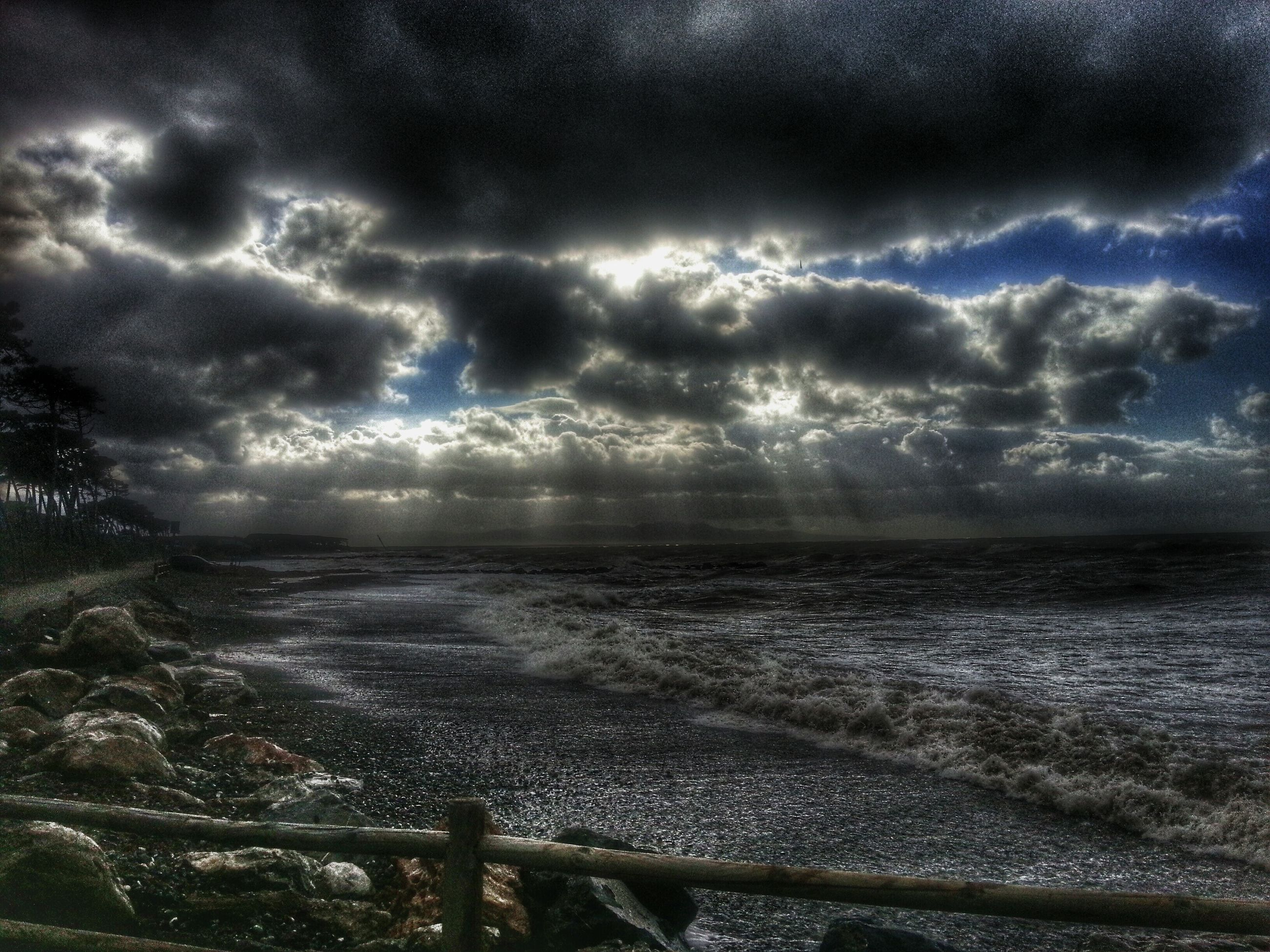 sky, water, cloud - sky, sea, cloudy, scenics, tranquil scene, horizon over water, tranquility, beauty in nature, weather, nature, overcast, storm cloud, cloud, idyllic, beach, shore, dramatic sky, outdoors