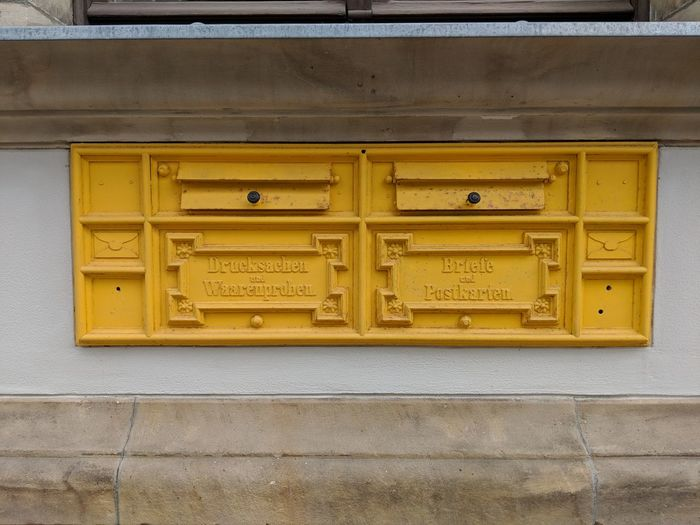 Historical Postbox Neustrelitz Postkasten City Full Frame Pattern Gold Colored Carving - Craft Product Close-up Architecture Architectural Feature Mail Slot Public Mailbox Mailbox