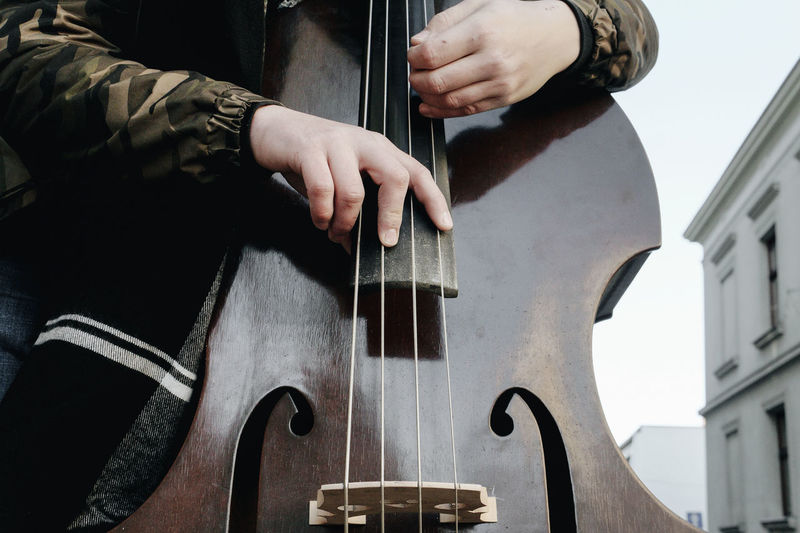 Arts Culture And Entertainment Background Close-up Contrabass Day Guitar Human Hand Indoors  Men Music Musical Instrument Musical Instrument String Musician Musicians One Person Playing Real People Skill