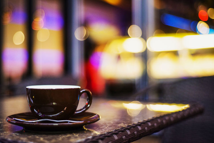 expresso coffee cup in bar at night Coffee Bar Cafe Close-up Coffee - Drink Coffee Break Coffee Cup Drink Expresso  Focus On Foreground Illuminated Indoors  Night No People Saucer Table