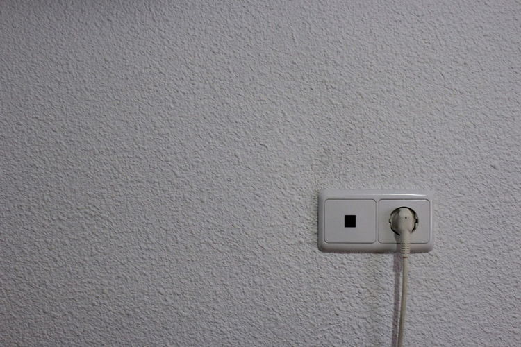 Architecture Built Structure Cable Close-up Connection Control Copy Space Electric Plug Electrical Component Electrical Equipment Electricity  Fuel And Power Generation Indoors  Light Switch No People Outlet Power Supply Push Button Switch Technology Wall - Building Feature White Color