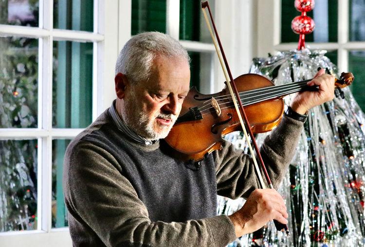 Senior man playing violin