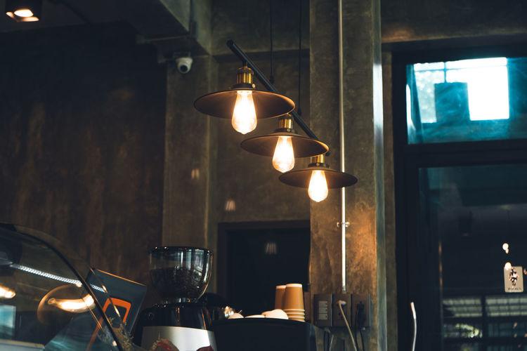Illuminated pendant light in restaurant