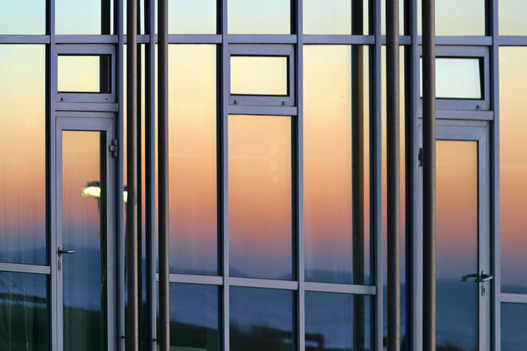 Full frame shot of glass window with building
