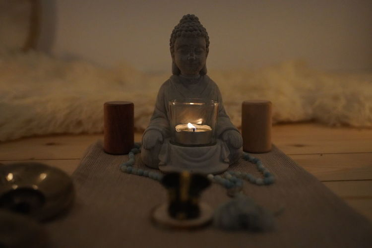 Buddha statue on table