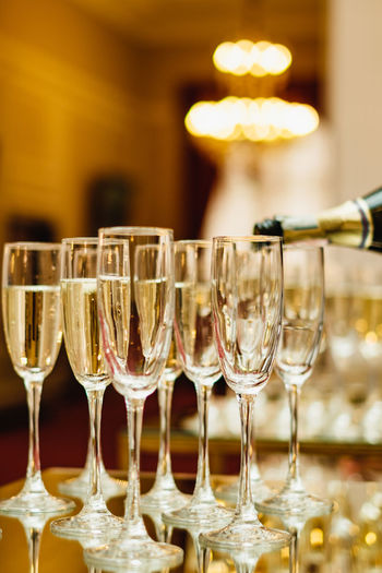 Luxury drink background. Glasses with prosecco Alcohol Refreshment Prosseco Food And Drink Glass - Material Wineglass Wine Bottle Focus On Foreground Drink White Wine Drinking Glass Wine No People Transparent Winetasting Container Red Wine Glass Luxury Household Equipment Table Bottle New Year Celebrating