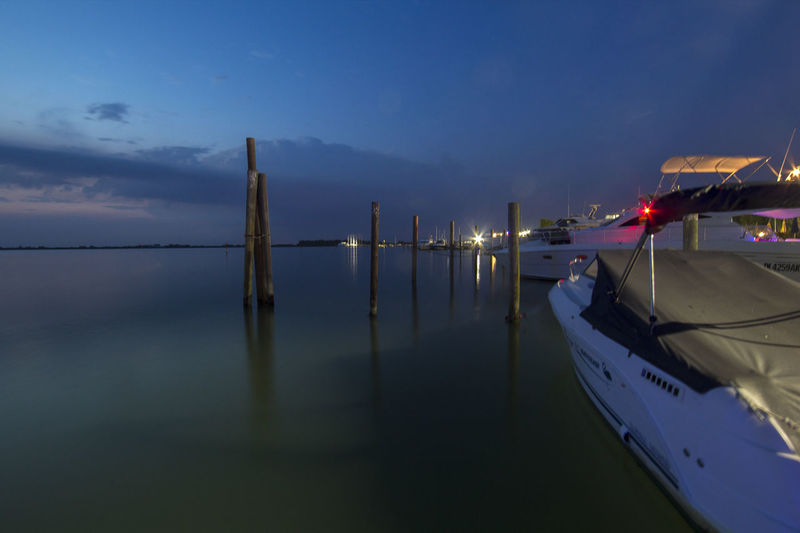 La Calma - Calm Porto Baseleghe - Bibione Pineda (VE) - Italy 10mm Bibione Blue Hour Boat Calm Canon Cloud Cloud - Sky EOS F/2.8 Illuminated Landscape Pole Port Rebel Samyang Sea Sunset T3i Tranquility First Eyeem Photo