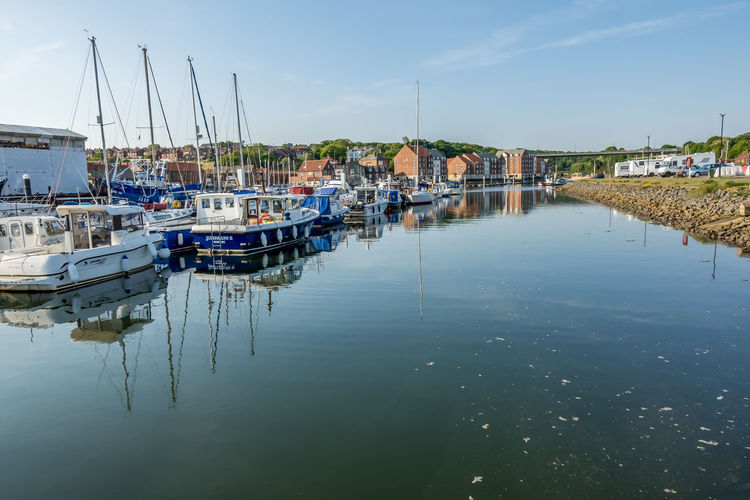 Whitby Whitby Harbour Whitby View Whitby North Yorkshire North Yorkshire Yorkshire Tourist Destination Sunny Day Blue Sky Seaside Seaside Town Marina Yacht Fishing Industry No People Waterfront Harbor Moored Sailboat Reflection Nautical Vessel Water Transportation Sea Outdoors