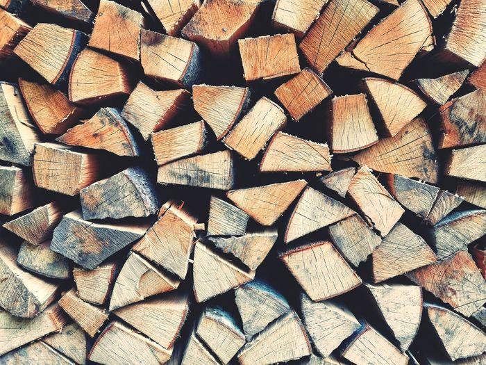 Full frame of a pile of split firewood