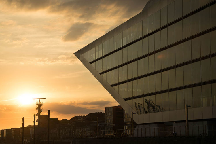 Hamburg Dockland by www.eightTWOeightSIX.de Dockland Hamburg Architecture Building Exterior Sunset Built Structure City Sky Building Reflection Office Building Sun Orange ColorGermany Hamburger Hafen Hamburg Harbour Elbe River Evening Water Elberiver Hafencity Cloud Modern Low Angle View The Architect - 2017 EyeEm Awards Colour Your Horizn