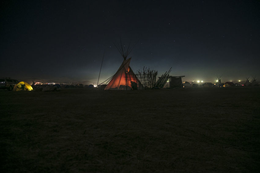 North Dakota USA. Oceti Sakowin prayer camp. Arts Culture And Entertainment Astronomy Camping Environmental Conservation Illuminated Landscape Native Native American Indian Nature Night No People Outdoors Sky Space And Astronomy Teepee Travel